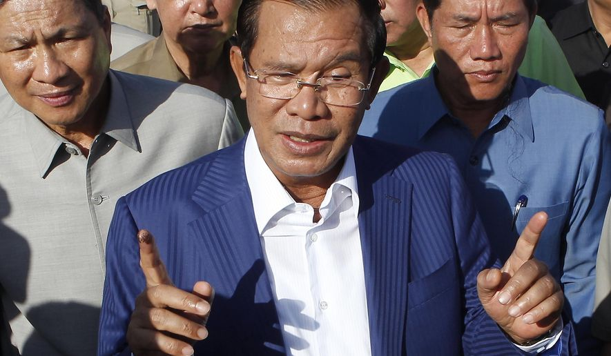 FILE - In this Aug. 1, 2018, file photo, Cambodian Prime Minister Hun Sen gestures while speaking in Phnom Penh, Cambodia. Cambodian Prime Minister Hun Sen, at the polling place near his home on the day of the general election on July 29, 2018. The official results, being announced province-by-province and party-by-party Wednesday, Aug. 15, 2018, were certain to confirm a landslide victory by Hun Sen's Cambodian People's Party, but critics called the election unfair because the only credible opposition force, the Cambodia National Rescue Party, could not contest the polls because it was dissolved by court order last year. (AP Photo/Heng Sinith, File)