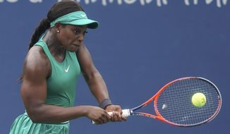 Sloane Stephens returns to Tatjana Maria, of Germany, in the second round at the Western & Southern Open tennis tournament, Wednesday, Aug. 15, 2018, in Mason, Ohio. (AP Photo/John Minchillo)