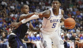 Duke's R.J. Barrett is guarded by Ryerson's Myles Charvis, left, during an exhibition basketball game in Mississauga, Ontario, Wednesday, Aug. 15, 2018. (Mark Blinch/The Canadian Press via AP
