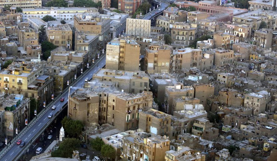 This July 18, 2014, file photo, shows buildings, to the right of the bridge, that are to be demolished as part of a redevelopment plan in the Maspero neighborhood of Cairo, Egypt. (AP Photo/Amr Nabil) ** FILE **