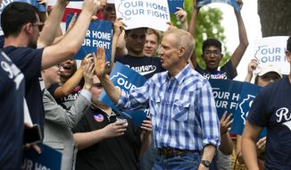Gov. Bruce Rauner greets supporters before he takes the stage at Governor's Day Wednesday, Aug. 15, 2018 at the Illinois State Fair in Springfield, Ill. (Rich Saal/The State Journal-Register via AP)