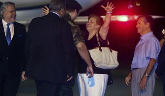 """Greek soldiers Dimitros Kouklatzis, center is welcomed by his parents at the airport of the the northern city of Thessaloniki , after spending months with another Greek soldier in a Turkish prison, early Wednesday, Aug. 15, 2018. The men were arrested on March 1, 2018 for illegally entering Turkey after crossing the heavily militarized land border. Greek Prime Minister Alexis Tsipras has hailed the decision as """"an act of justice"""" that will help boost friendship between the two historic regional rivals.(Yannis Moisiadis /InTime News via AP)"""