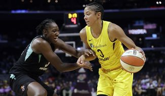 Los Angeles Sparks' Candace Parker, right, is defended by New York Liberty's Tina Charles during the first half of a WNBA basketball game Tuesday, Aug. 14, 2018, in Los Angeles. (AP Photo/Marcio Jose Sanchez)