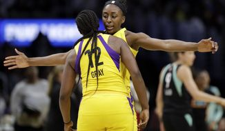 Los Angeles Sparks' Nneka Ogwumike, center right, celebrates after scoring with teammate Chelsea Gray (12) during the second half of a WNBA basketball game against the New York Liberty, Tuesday, Aug. 14, 2018, in Los Angeles. (AP Photo/Marcio Jose Sanchez)