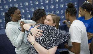 Minnesota Lynx guard Lindsay Whalen is hugged by her teammates after she announced her retirement during a news conference at Mayo Square, Monday, Aug. 13, 2018 in Minneapolis, Minn. Whalen led the Lynx to four WNBA championships and appeared in six All-Star games. (Elizabeth Flores/Star Tribune via AP)