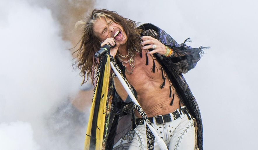 """FILE - In this May 5, 2018 file photo, Steven Tyler of Aerosmith performs at the New Orleans Jazz and Heritage Festival in New Orleans.  The rock band announced Wednesday, Aug. 15,  that """"Aerosmith: Deuces are Wild"""" would kick off April 6, 2019, at the Park Theater, where Lady Gaga will launch her residency in December.(Photo by Amy Harris/Invision/AP, File)"""