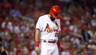 St. Louis Cardinals' Matt Carpenter hangs his head after being hit by a pitch during the seventh inning of a baseball game against the Washington Nationals on Wednesday, Aug. 15, 2018, in St. Louis. Carpenter left the game. (AP Photo/Jeff Roberson)