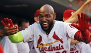 St. Louis Cardinals' Marcell Ozuna is congratulated by teammates after hitting a solo home run during the second inning of the team's baseball game against the Washington Nationals on Wednesday, Aug. 15, 2018, in St. Louis. (AP Photo/Jeff Roberson)