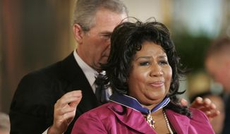 In this Nov. 9, 2005 file photo, President George W. Bush awards singer Aretha Franklin the Presidential Medal of Freedom Award, the highest civilian award, in the East Room of the White House in Washington. A person close to Franklin said on Monday that the 76-year-old singer is ill. Franklin canceled planned concerts earlier this year after she was ordered by her doctor to stay off the road and rest up. (AP Photo/Lawrence Jackson, File)