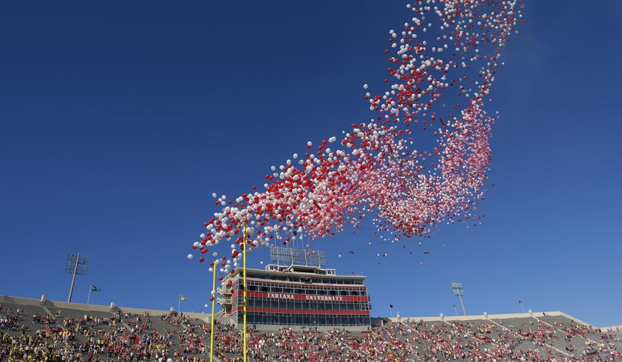 In this Oct. 14, 2017, file photo balloons are released in Memorial Stadium before an NCAA college football game between Indiana and Michigan in Bloomington, Ind. The celebration of releasing balloons into the air has long bothered environmentalists, who say the pieces that fall back to earth can be deadly to seabirds and turtles that eat them. So as companies vow to banish plastic straws, there are signs balloons are among the products getting more scrutiny. (AP Photo/AJ Mast, File)
