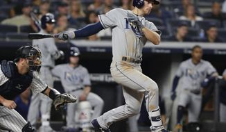 Tampa Bay Rays' Brandon Lowe watches his RBI single during the fifth inning of a baseball game against the New York Yankees on Wednesday, Aug. 15, 2018, in New York. (AP Photo/Frank Franklin II)