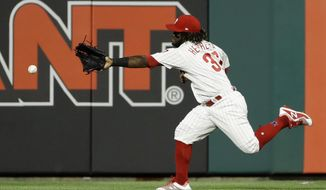 Philadelphia Phillies center fielder Odubel Herrera cannot reach a three-run double by Boston Red Sox's Mitch Moreland during the third inning of a baseball game Wednesday, Aug. 15, 2018, in Philadelphia. (AP Photo/Matt Slocum)
