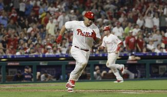 Philadelphia Phillies' Wilson Ramos, left, runs after hitting a two-run double off Boston Red Sox relief pitcher Drew Pomeranz during the seventh inning of a baseball game Wednesday, Aug. 15, 2018, in Philadelphia. Philadelphia won 7-4. (AP Photo/Matt Slocum) **FILE**