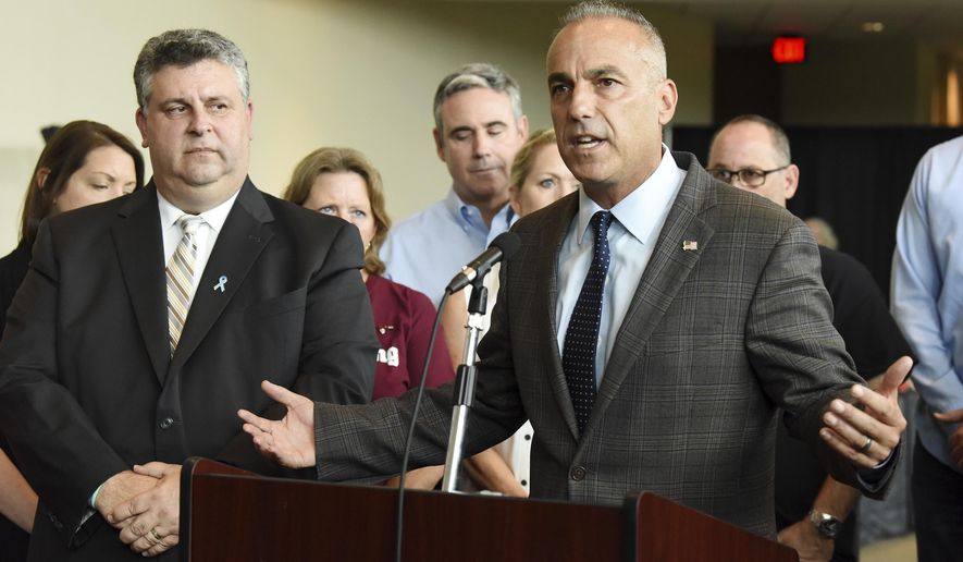 "Andrew Pollack and parents of students killed in the Parkland massacres speak during a news conference Thursday, Aug. 9, 2018, where they call for changes in the school system, naming the school board's ""poor performance"" as a specific target at the BB&T Center in Sunrise, Fla. The Broward County School Board has failed to properly secure the county's 234 schools for the upcoming school year, according to a statement from Stand With Parkland, the National Association of Families for Safe Schools. The shooting on Feb. 14 at Marjory Stoneman Douglas High School killed 17 students and staff. (Taimy Alvarez/South Florida Sun-Sentinel via AP)"