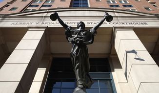 A statue of Justice is seen at federal court in this file photo from Alexandria, Va., Wednesday, Aug. 15, 2018. (AP Photo/Jacquelyn Martin) **FILE**