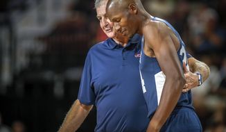 In this Friday, Aug. 10, 2018, photo, former UConn head basketball coach Jim Calhoun wraps his arm around former UConn and NBA star Ray Allen during Connecticut's alumni basketball game in Uncasville, Conn. Calhoun, who hosted the biannual charity game, believes the UConn program remains championship caliber. (Mark Mirko/Hartford Courant via AP)