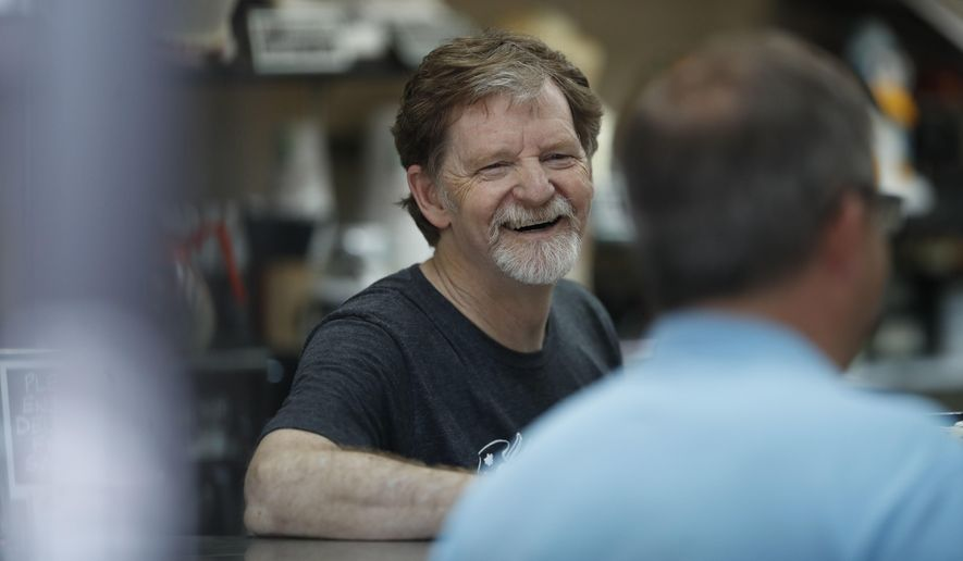 Baker Jack Phillips, owner of Masterpiece Cakeshop, manages his shop after a U.S. Supreme Court issued a limited ruling in his favor after he refused to make a wedding cake for a same-sex couple, June 4, 2018. He is suing Colorado after officials ruled against him in another alleged discrimination case in which his shop refused to make a cake celebrating a gender transition. (AP Photo/David Zalubowski) ** FILE **