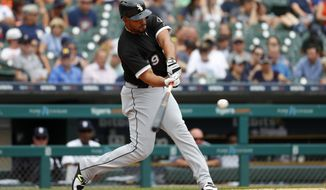 Chicago White Sox's Jose Abreu hits a two-run home run in the fifth inning of a baseball game against the Detroit Tigers in Detroit, Wednesday, Aug. 15, 2018. (AP Photo/Paul Sancya)