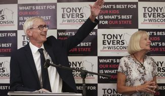 Tony Evers, with his wife, Kathy, speaks after his win in Wisconsin's Democratic gubernatorial primary election during an event at Best Western Premier Park Hotel in Madison, Wis., Tuesday, Aug. 14, 2018. (Amber Arnold/Wisconsin State Journal via AP)