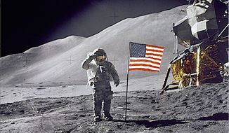 "A historic image from Aug. 1, 1971: astronaut David R. Scott gives a military salute during Apollo 15 lunar surface ""extravehicular activity."" (NASA)"