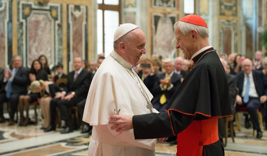 Pope Francis (left) talks with Papal Foundation Chairman Cardinal Donald Wuerl, Archbishop of Washinghton, D.C., during a meeting with members of the Papal Foundation at the Vatican on Oct. 20, 2010. On Tuesday, Aug. 15, 2018, a Pennsylvania grand jury accused Cardinal Wuerl of helping to protect abusive priests when he was Pittsburgh's bishop. (L'Osservatore Romano/Pool Photo via AP) **FILE**