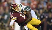 New York Jets linebacker Jordan Jenkins (48) hits Washington Redskins quarterback Alex Smith (11) during the first half of a preseason NFL football game, Thursday, Aug. 16, 2018, in Landover, Md. Jenkins was penalized for roughing the passer on the play. (AP Photo/Nick Wass)