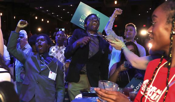 Supporters cheer as Michigan Democratic gubernatorial candidate Gretchen Whitmer is declared the winner in the primary, Tuesday, Aug. 7, 2018, in Detroit. Whitmer will face Republican Bill Schuette in November. (AP Photo/Carlos Osorio)