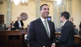 FCC Chairman Ajit Pai arrives to testify as the Senate Committee on Commerce, Science, and Transportation holds an oversight hearing on the Federal Communications Commission, on Capitol Hill in Washington, Thursday, Aug. 16, 2018. (AP Photo/J. Scott Applewhite)