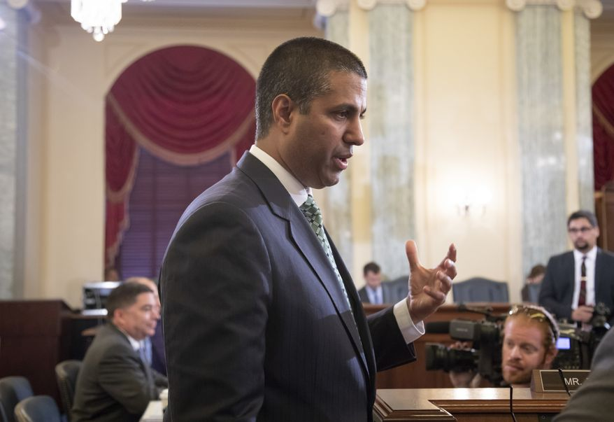 FCC Chairman Ajit Pai speaks with Sen. Jon Tester, D-Mont., as the Senate Committee on Commerce, Science, and Transportation holds an oversight hearing on the Federal Communications Commission, on Capitol Hill in Washington, Thursday, Aug. 16, 2018. (AP Photo/J. Scott Applewhite) ** FILE **
