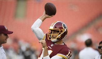 Washington Redskins quarterback Alex Smith warms up for the team's preseason NFL football game against the New York Jets, Thursday, Aug. 16, 2018, in Landover, Md. (AP Photo/Nick Wass) ** FILE **