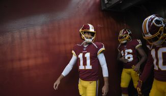 Washington Redskins quarterback Alex Smith (11) walks in the tunnel next to wide receiver Shay Fields (16) and wide receiver Paul Richardson (10) before the team's preseason NFL football game against the New York Jets, Thursday, Aug. 16, 2018, in Landover, Md. (AP Photo/Nick Wass)