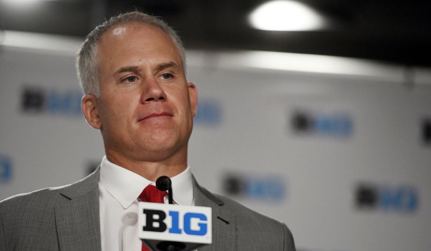 FILE - In this July 24, 2018, file photo, Maryland head coach DJ Durkin speaks at the Big Ten Conference NCAA college football media days in Chicago. The parents of offensive lineman Jordan McNair say suspended University of Maryland coach DJ Durkin should be fired. McNair collapsed during a preseason conditioning drill May 29 and died two weeks later. Durkin was placed on administrative leave Saturday, Aug. 11, after ESPN reported that coaches had been bullying the players. (AP Photo/Annie Rice) ** FILE **