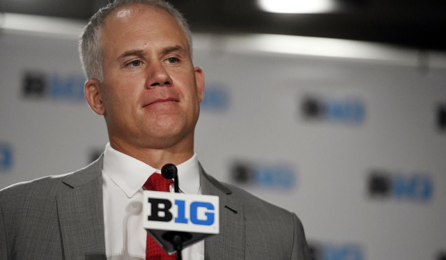 FILE - In this July 24, 2018, file photo, Maryland head coach DJ Durkin speaks at the Big Ten Conference NCAA college football media days in Chicago. The parents of offensive lineman Jordan McNair say suspended University of Maryland coach DJ Durkin should be fired. McNair collapsed during a preseason conditioning drill May 29 and died two weeks later. Durkin was placed on administrative leave Saturday, Aug. 11, after ESPN reported that coaches had been bullying the players. (AP Photo/Annie Rice, File)