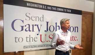 Former Libertarian presidential candidate and New Mexico U.S. Senate race candidate Gary Johnson talks to reporters Thursday, Aug. 16, 2018, during a media availability in Albuquerque, N.M. Johnson talked about his decision to join the race and how he would represent a state dependent on three military bases and two national labs. (AP Photo/Russell Contreras)