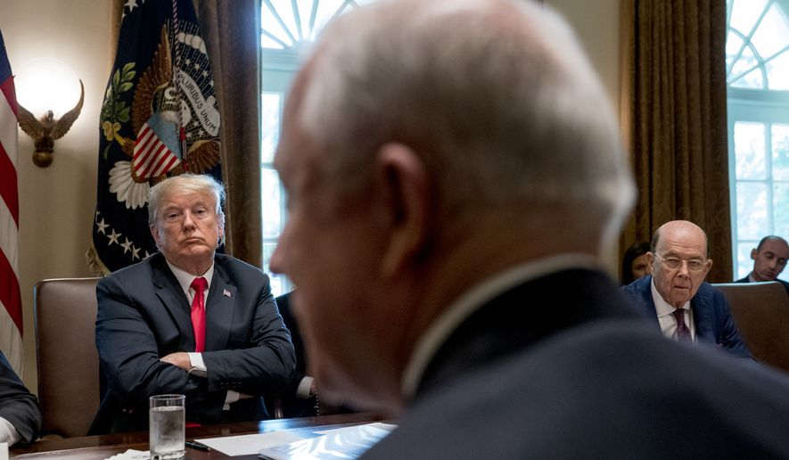 President Donald Trump, left, listens as Attorney General Jeff Sessions, foreground, speaks during a cabinet meeting in the Cabinet Room of the White House, Thursday, Aug. 16, 2018, in Washington. Also pictured is Commerce Secretary Wilbur Ross, right. (AP Photo/Andrew Harnik)