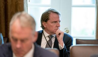 White House counsel Donald McGahn attends a cabinet meeting in the Cabinet Room of the White House, Thursday, Aug. 16, 2018, in Washington. (AP Photo/Andrew Harnik)
