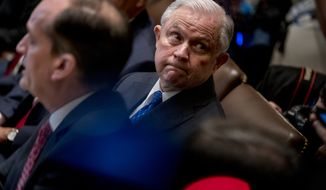 Attorney General Jeff Sessions attends a cabinet meeting in the Cabinet Room of the White House, Thursday, Aug. 16, 2018, in Washington. (AP Photo/Andrew Harnik)