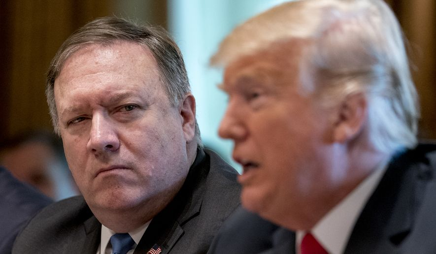President Donald Trump, accompanied by Secretary of State Mike Pompeo, left, speaks during a cabinet meeting in the Cabinet Room of the White House, Thursday, Aug. 16, 2018, in Washington. (AP Photo/Andrew Harnik)