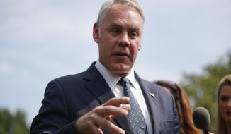 Interior Secretary Ryan Zinke speaks to members of the media outside the White House in Washington, Thursday, Aug. 16, 2018. (AP Photo/Pablo Martinez Monsivais)