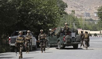 Afghan security forces arrive at the site of an attack by gunmen, in Kabul, Afghanistan, Thursday, Aug. 16, 2018. Gunmen besieged a compound belonging to the Afghan intelligence service in Kabul on Thursday, police said, as the city's Shiite residents held funeral services for the victims of a horrific suicide bombing the previous day that left over 30 dead. (AP Photo/Rahmat Gul)