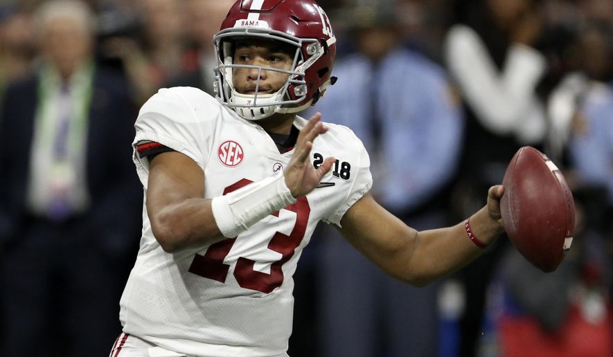 File-This Jan. 8, 2018, file photo shows Alabama quarterback Tua Tagovailoa (13) looking to pass against Georgia during the College Football Playoff national championship game in Atlanta, Ga. The quarterback battle between 28-game starter Jalen Hurts and Tagovailoa has hogged the headlines, overshadowing the fact that eight members of the nation's top defense were drafted. Gone are the starting secondary, including All-American Minkah Fitzpatrick, and a top reserve.  (C.B. Schmelter/Chattanooga Times Free Press via AP, File)
