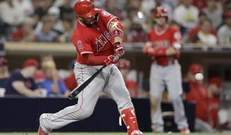 Los Angeles Angels' Rene Rivera hits a home run during the ninth inning against the San Diego Padres in a baseball game Wednesday, Aug. 15, 2018, in San Diego. (AP Photo/Gregory Bull)