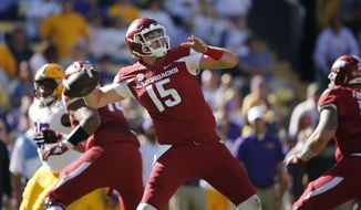 FILE - In this Nov. 11, 2017, file photo, Arkansas quarterback Cole Kelley (15) passes in the second half of an NCAA college football game against LSU in Baton Rouge, La. (AP Photo/Gerald Herbert)