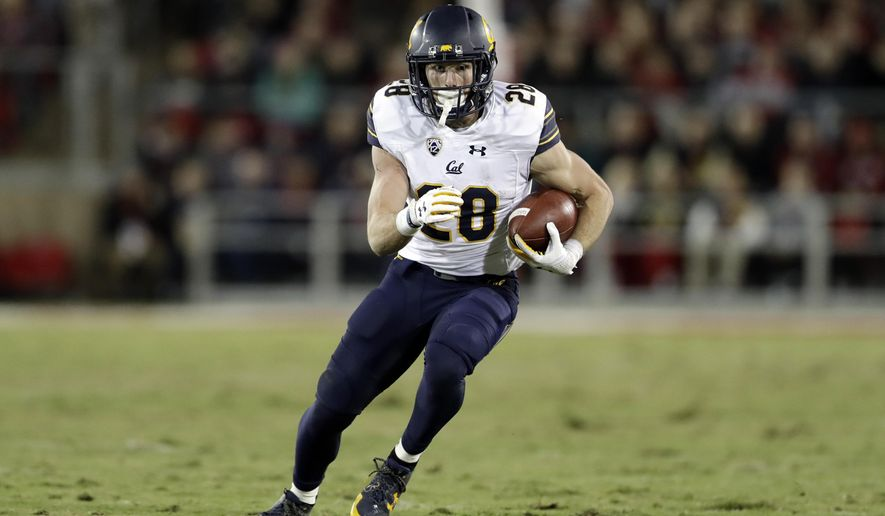 """FILE - In this Nov. 18, 2017, file photo, California running back Patrick Laird runs against Stanford during the first half of an NCAA college football game in Stanford, Calif. Cal now hopes that the increased focus on defense that led to 14 fewer points per game allowed and the culture change that head coach Justin Wilcox instilled in year one leads to a bowl game this season. """"It's a transition to more of a winning mentality,"""" running back Patrick Laird said. """"In the past, there's been not a victim mentality, but things are tough, it's hard for us to win. Now we feel like we can win. ... Everyone collectively feels we are capable of winning and we can do it."""" (AP Photo/Marcio Jose Sanchez, File)"""