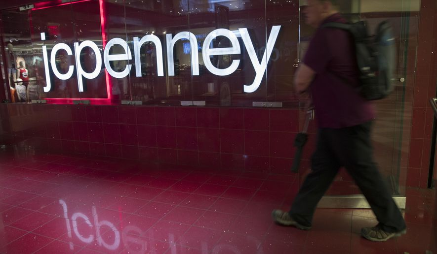 FILE- In this May 16, 2018, file photo, a man enters the JC Penney store at the Manhattan mall in New York. J.C. Penney Co. reports earnings Thursday, Aug. 16. (AP Photo/Mary Altaffer, File)