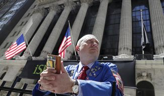 FILE- In this April 26, 2018, file photo, Vincent Pepe enjoys some fresh air outside the New York Stock Exchange where he works trading cotton shares for VLM Commodities in the Financial District in New York. The U.S. stock market opens at 9:30 a.m. EDT on Thursday, Aug 16. (AP Photo/Kathy Willens, File)