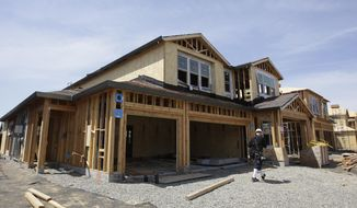 FILE- This May 4, 2018, file photo shows a house under construction in Roseville, Calif. On Thursday, Aug. 16, the Commerce Department reports on U.S. home construction in July. (AP Photo/Rich Pedroncelli, File)