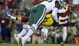 New York Jets linebacker Jordan Jenkins (48) hits Washington Redskins quarterback Alex Smith (11) during the first half of a preseason NFL football game Thursday, Aug. 16, 2018, in Landover, Md. (AP Photo/Alex Brandon)