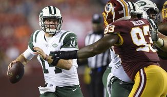 New York Jets quarterback Sam Darnold (14) looks to pass as Washington Redskins defensive end Jonathan Allen (93) is blocked during the first half of a preseason NFL football game Thursday, Aug. 16, 2018, in Landover, Md. (AP Photo/Nick Wass)
