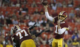 Washington Redskins quarterback Alex Smith throws during the first half of the team's preseason NFL football game against the New York Jets. Thursday, Aug. 16, 2018, in Landover, Md. (AP Photo/Alex Brandon)